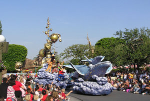 Daytime and nighttime parades that celebrate Disney films or seasonal holidays with characters, music, and large floats