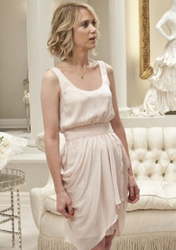 Kristen Wiig's light pink bridesmaid dress in Bridesmaids