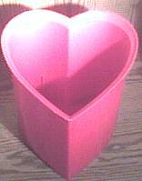 red heart-shaped trash can