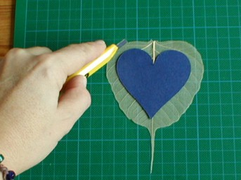 cutting large heart from skeleton leaf