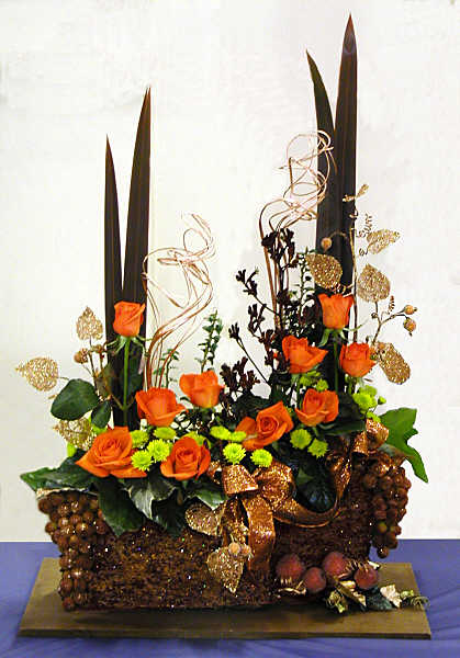 orange copper bronze christmas flower arrangement