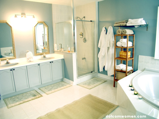 blue bathroom with ornate mirrors and fluffy towels and robes
