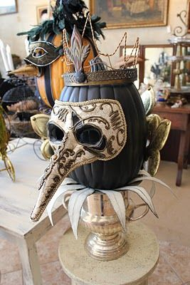 Black painted pumpkin with Mask - Decorating for a Halloween masquerade party