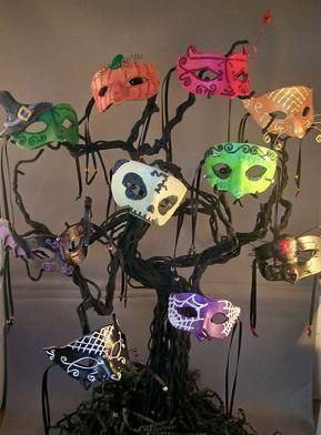 Halloween masks tree decoration idea for a Masquerade Party